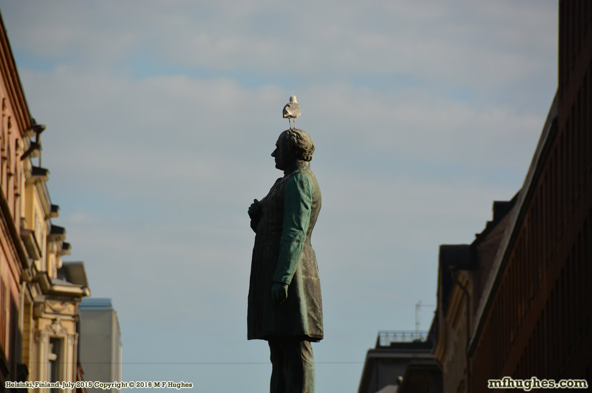 Statue with pigeon